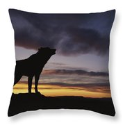 Howling Wolf Silhouetted Against Sunset Throw Pillow