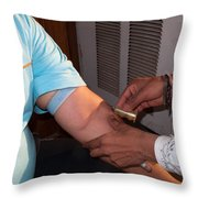 Inserting The First Part Of The Blood Test Collection Apparatus Throw Pillow