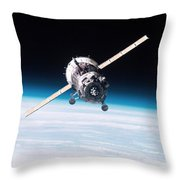 Iss Crew Arriving By Soyuz Spacecraft Throw Pillow by NASA / Science Source