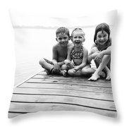 Kids Sitting On Dock Throw Pillow