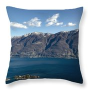 lake with Brissago islands and snow-capped mountain Throw Pillow