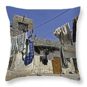 Laundry Hangs In The Courtyard Throw Pillow by Stocktrek Images