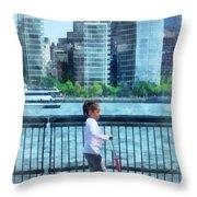 Little Girl On Scooter By Manhattan Skyline Throw Pillow