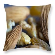 Macro Shots Of Various Dry Fruit Items Such As Almonds And Walnuts And Raisins Throw Pillow