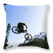Man Jumping On His Mountain Bike Throw Pillow