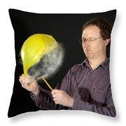 Man Popping A Balloon Throw Pillow