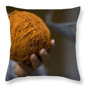 Mans Hand Holds Ball Of Orange Wool Throw Pillow