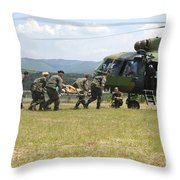 Medical Personnel Carry A Wounded Throw Pillow