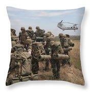 Midshipmen Watch As A U.s. Marine Corps Throw Pillow