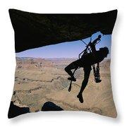 Miles Kunkel Uses Aid To Climb An Throw Pillow