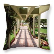 Mix Of Light And Shade Under A Partially Covered Pathway With Pillars Throw Pillow