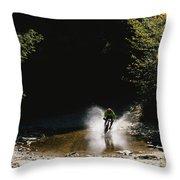 Mountain Biker Splashing Through Water Throw Pillow