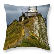 Nugget Point Light House And Dark Clouds In The Sky Throw Pillow