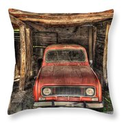 Old Red Car In A Wood Garage Throw Pillow
