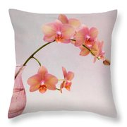 Orchids In A Pink Vase Throw Pillow