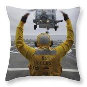 Petty Officer Guides An Sh-60r Sea Hawk Throw Pillow