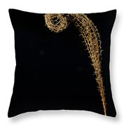 Plant Uncurling Against Black Throw Pillow