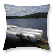 Racks Of Canoe's On Bear Pond Lake In The Adirondacks Ny Throw Pillow