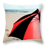 Red And Black Umbrella On The Beach With Footprints Throw Pillow