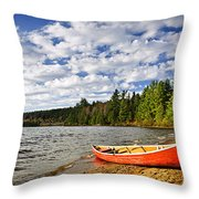 Red Canoe On Lake Shore Throw Pillow
