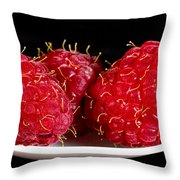 Red Raspberries On A White Spoon Against Black No.0102 Throw Pillow
