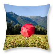 Red Umbrella On The Field Throw Pillow