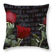 Roses Glow Against The Black Granite Throw Pillow