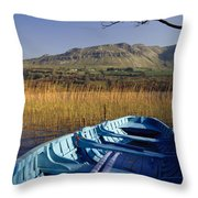 Row Boat Amongst Reeds On A Lake Throw Pillow