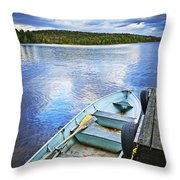 Rowboat Docked On Lake Throw Pillow by Elena Elisseeva