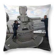 Sailors Conduct Maintenance On The Mk38 Throw Pillow