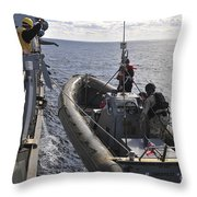 Sailors Lift A Rigid-hull Inflatable Throw Pillow