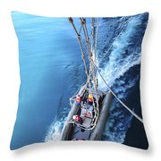 Sailors Release Lines From A Rigid Hull Throw Pillow