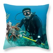 Scuba Diver With Spear Of Invasive Throw Pillow