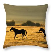 Silhouetted Horses Running Throw Pillow