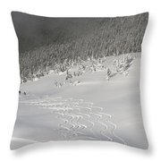 Skiers At The Base Of A Mountain Throw Pillow