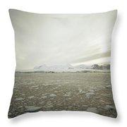 Slush Fills The Sea Under A Cloudy Sky Throw Pillow