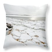 Small Boat Sits On Ice Chuncks In Wellfleet On Cape Cod In Winte Throw Pillow