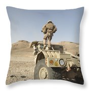 Soldier Climbs A Damaged Husky Tactical Throw Pillow by Stocktrek Images