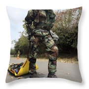 Soldier Drags A Simulated Attack Victim Throw Pillow