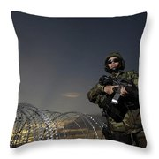 Soldier Patrols The Perimeter Of Camp Throw Pillow