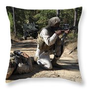 Soldier Provides Security To A Casualty Throw Pillow