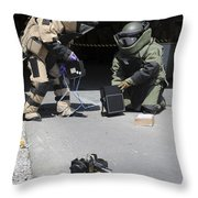 Soldiers Dressed In Bomb Suits Examine Throw Pillow