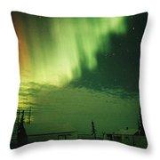 The Aurora Borealis Shimmers Throw Pillow