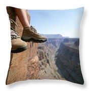 The Boot-shod Feet Of A Hiker Dangle Throw Pillow