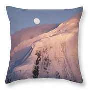 The Moon Rises Over Snow-blown Peaks Throw Pillow