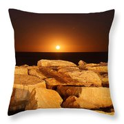The Moon Rising Behind Rocks Lit Throw Pillow