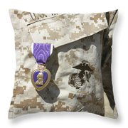 The Purple Heart Award Hangs Throw Pillow by Stocktrek Images