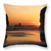 The Sun Sets Over The Sea Stacks Throw Pillow