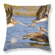 Three Pelicans Taking Off Throw Pillow