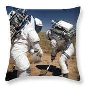Two Astronauts Collect Soil Samples Throw Pillow by Stocktrek Images